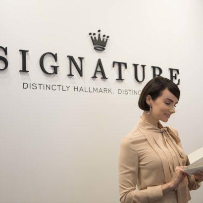 Veronica Summer enjoys a Hallmark Signature Card
