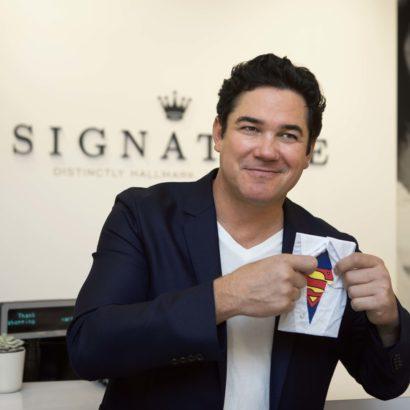 Dean Cain Poses with a Hallmark Signature Card