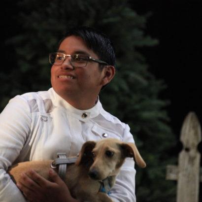 Peyton holding his dog, Luke