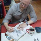 Hallmark Cards' master artist and illustrator, Geoff Greenleaf on set working on an illustration