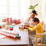Image of mother and daughter wrapping gifts